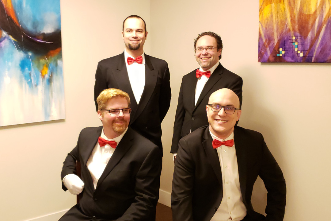 the members of slow no tempo decked out in their singing valentine's suits